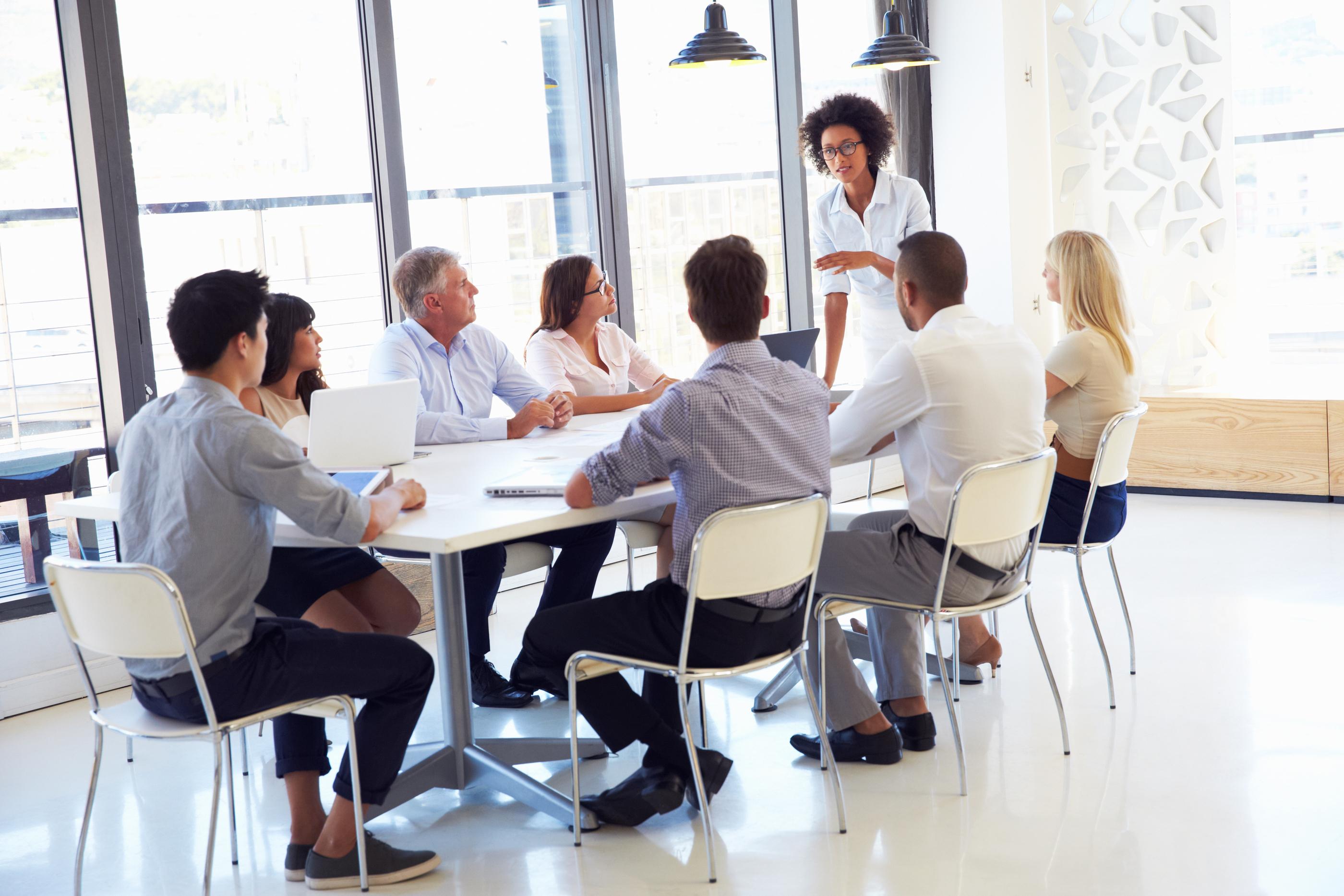 bigstock-Businesswoman-presenting-to-co-90005828