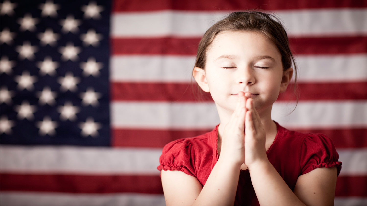 girlprayingamericanflag-blog-050516