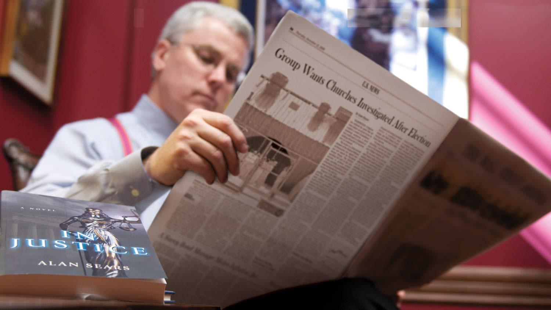 img-Alan-reading-paper
